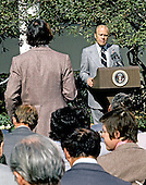 United States President Gerald R. Ford listens to a reporter's question during a press conference in the Rose Garden at the White House in Washington, D.C. on October 9, 1974.  The President said he did not think the country was in a depression and that inflation would be reduced in 1975.  He also said his proposed 5% tax would not extend beyond 1975.  Ford is wearing a red button with the letters &quot;WIN&quot; on his lapel.  &quot;WIN&quot; stands for &quot;Whip Inflation Now&quot;.<br /> Credit: Barry Soorenko - CNP