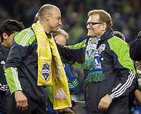Seattle Sounders FC goalkeeper Kasey Keller is congratulated by team co-owner Drew Carey following match against the San Jose Earthquakes at CenturyLink Field in Seattle Saturday October 15, 2011. The Sounders FC won the game 2-1. The game was Keller's last regular season home game.