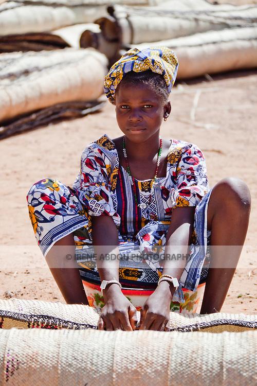 Awoman sells  straw mats at the weekly market in Djibo in northern Burkina Faso.