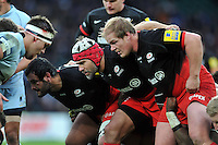 The Saracens front row of Juan Figallo, Schalk Brits and Rhys Gill prepare to scrummage. Aviva Premiership match, between Saracens and Worcester Warriors on November 28, 2015 at Twickenham Stadium in London, England. Photo by: Patrick Khachfe / JMP