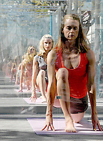 Ten Yoga models pose their new spring workout wear from Adidas by Stella McCartney while going through a synchronized yoga routine in front of the Adidas store  during a promotion on the Third Street Promenade in Santa Monica on Saturday March 18, 2006.