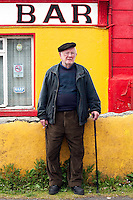 Local man at the Star Bar, Inis Mór, Aaran Islands, County Galway, Ireland..The island of Inis Mór ( meaning the big island) is one of the most popular tourist destinations in Ireland. The islands inland landscape of uniquely blanketed rock surface are glazed with man made rock walls that meander and cross all directions as far as one can see. Well known internationally, it is steeped in history and resembles an outdoor museum with over 50 different monuments of Christian, pre Christian and Celtic mythological heritage. Picture James Horan
