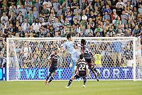 Roger Espinoza Sporting KC midfielder wins the aeriel battle... Sporting Kansas City defeated New England Revolution 3-0 at LIVESTRONG Sporting Park, Kansas City, Kansas.