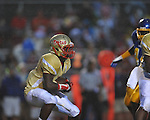Oxford High vs.Lafayette High's D.K. Buford (2) at Bobby Holcomb Field in Oxford, Miss. on Thursday, August 30, 2012. Oxford High won 19-0.