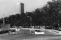 COLUMBUS, OH - OCTOBER 6: The Budweiser/Dyson Racing Porsche 962 101 driven by Price Cobb and Drake Olsen leads a pair of prototype cars en route to victory in the Columbus Ford Dealers 500 IMSA GTP/Lights race at the temporary Columbus Street Circuit in Columbus, Ohio on October 6, 1985.