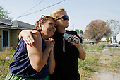 Saint Bernard's Parish, Louisiana.May 31, 2006..Nanette Hery is comforted by her 21 year old daughter Nicole as they watch their home of 25 years being demolished after suffering major damage from flooding druing hurricane Katrina. Their home in Saint Bernard's Parish was flooded by waters coming from the Industrial Canal levee break. They plan to rebuild a new house on stilts.