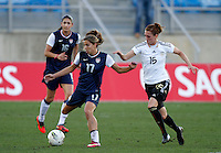 USA's Tobin Heath fights for the ball with Germany's Verena Faibt during their Algarve Women's Cup soccer match at Algarve stadium in Faro, March 13, 2013.  .