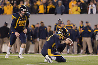 WVU kicker Tyler Bitancurt (40) gets ready to kick the extra point. The WVU Mountaineers beat the Pitt Panthers 21-20 at Mountaineer Field in Morgantown, West Virginia on November 25, 2011.