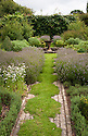 """The Herb Garden at Clinton Lodge Garden, Fletching, East Sussex, early August. """"The paths of camomile are designed to release their fragrance at the touch of a foot, or in earlier centuries the hem of a long dress."""""""