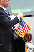 Secret Service agents attach U.S. flags to a motorcade vehicle during the 2017 Presidential Inauguration at the US Capitol in Washington, DC on January 20, 2017.<br /> Credit: Jack Gruber / Pool via CNP