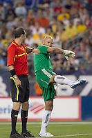 New England Revolution goalkeeper Matt Reis (1) discusses penalty kick call by Paul Ward. The New England Revolution tied Columbus Crew, 2-2, at Gillette Stadium on September 25, 2010.