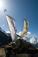 "Prayer flags flutter in the breeze atop many of the small summits along the trails in Nepla's The Khumbu region. Nepal's Himalayas are visited by thousands of trekkers each year who usually fly into the small town of Lukla before heading north along the ""Everest Highway."""