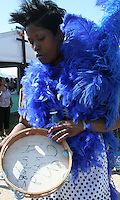 9th ward tambourine player,blue feathered costume