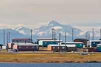 Native Inupiat village of Kaktovik on Barter Island, arctic coast of Alaska. Romanzof mountains of the Brooks Range, ANWR, in the distance.