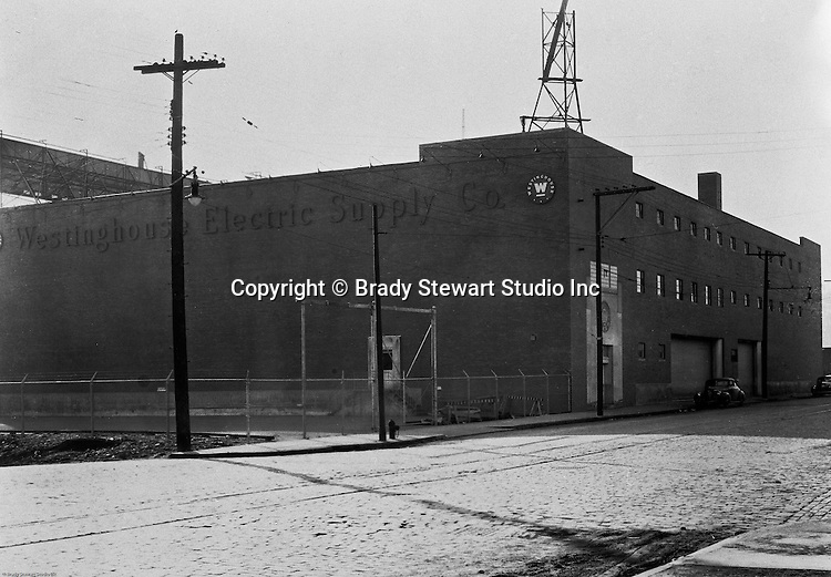 North Side of Pittsburgh:  View of the Westinghouse Electric Supply Company building (WESCO) on the North Side of Pittsburgh - 1957.  The WESCO building stood near Three Rivers Stadium on the banks of the Allegheny River just opposite Downtown Pittsburgh, and the sign was one of several large illuminated corporate billboards that became a fixture of Pittsburgh's evening skyline. The sign was removed in 1998 when the building on which it was mounted was demolished to make way for the construction of PNC Park.