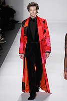 Model walks runway in a men's brilliant brush strokes silk satin smoking robe, men's black cotton velvet dinner suit+dupioni dressed shirt+bow tie, from the Zang Toi Fall 2012 &quot;Glamour At Gstaad&quot; collection, during Mercedes-Benz Fashion Week New York Fall 2012 at Lincoln Center.