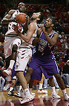 Jodi Miller Lubbock Avalanche-Journal.Tech's Martin Zeno (3) goes to the basket over teammate Esmir Rizvic (34) and TCU's Brent Hackett (12).