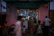 A local grocery store in Belgharia township outside of Dhanbad in Jharkhand, India. Families from various villages with underground fires have been rehabilitated in Belgharia township. Photo: Sanjit Das/Panos
