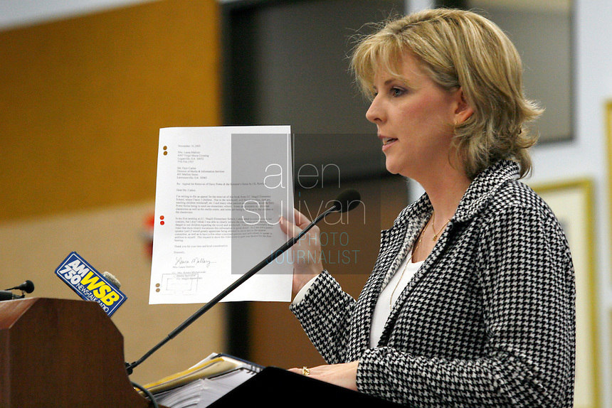 Laura Mallory, a mother from Loganville, Ga., speaks to hearing officer L.O. Buckland at the Georgia Board of Education in her effort to have &quot;Harry Potter&quot; books removed from the shelves in Gwinnett County public schools. Mallory argued that the books &quot;promote the particular religion of witchcraft&quot; and that children practice spells from the books. &quot;You would think we'd want to do everything we can to remove evil from our schools,&quot; she said. Mallory said that she has never read in full any of the &quot;Harry Potter&quot; books. Buckland will make a recommendation to the State Board of Education, but he did not say when that will occur.<br />