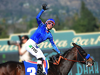 February 5, 2011.Chantal Sutherland, aboard Game On Dude celebrates winning the San Antonio Stakes at Santa Anita Park, Arcadia, CA