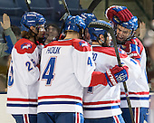 Dylan Zink (UML - 25), Joe Houk (UML - 4), Stephen Buco (UML - 11), Adam Chapie (UML - 13) - The University of Massachusetts Lowell River Hawks defeated the visiting American International College Yellow Jackets 6-1 on Tuesday, December 3, 2013, at Tsongas Arena in Lowell, Massachusetts.