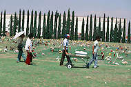 September 1984, September 1984, Gardena, CA. Pet Haven Cemetery of Gardena, CA, where more than 25.000 family pets lie buried, is the most famous animal cemetery in LA. Founded in 1948, this cemetery enables bereaved familys to mourn the death of their pets and to give them the burial they deserve. No expenses spared even $485 is spent on a dog service including flowers and grave stones marble and satin lined coffins. funeral