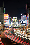 Traffic races through a major junction in Shinjuku, central Tokyo, Japan on 05 Feb. 2012. Photographer: Robert Gilhooly