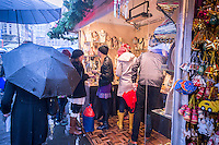"Shoppers browse the Union Square Holiday Market in New York on a rainy Saturday, December 6, 2014. 150 vendors, including a ""Made in Brooklyn"" section, sell their holiday wares at the market, now in it's 21st year. The market will remain open daily, closing on December 24.  (© Richard B. Levine)"
