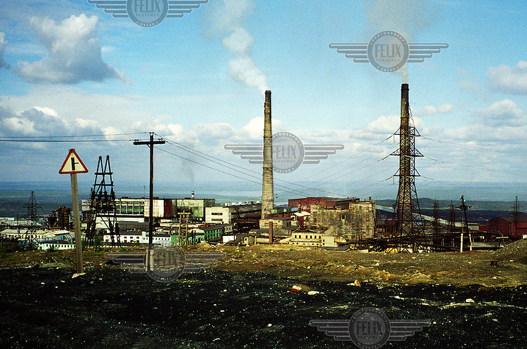 Smoke unfurls from chimney stacks at a factory in Murmansk. Nickel smelting, and other heavy industry, have heavily damaged the environment in this region.