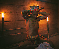 "Aman Lepon, a young Mentawai Shaman or usually called Sikerei, living in the village of Buttui is preparing himself before performing ""turuk laggai"", the Mentawai traditional dance. The Mentawai are the tribes living traditionally in the island of Siberut, Indonesia. Here, where the changes came slow, some of the people are still living like their ancestors did centuries ago. They s till practice ancient religion called Arat Sabulungan, which believe that everything in the forest has a spirit."