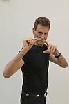 Uri Geller at home Berkshire England 2008. Bending spoon 2nd image taken at 16. 36. 04 pm.
