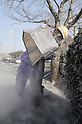 January 29, 2011, Takaharu-machi, Japan - A worker dumps volcanic ashes at the toll gate near Takaharu-machi in southern Japanfs Miyazaki prefecture is closed following the eruption of Mt. Shinmoe on Saturday, January 29, 2011. The 1,421-meter volcano spewed ashes and smoke over nearby towns in the first major eruption in 52 years. (Photo by AFLO) [3620] -mis-