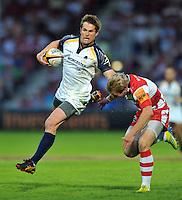 Errie Claassens goes on the attack. J.P. Morgan Premiership Rugby 7s match, between Gloucester Rugby and Worcester Warriors on July 27, 2012 at Kingsholm Stadium in Gloucester, England. Photo by: Patrick Khachfe / Onside Images