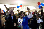 November 4, 2008. Greensboro, NC.. As news that NBC had called the presidential election for Democrat Barack Obama, people at a Democratic election watching party were overwhelmed.. Simone Hawks, center, reacted with friends.
