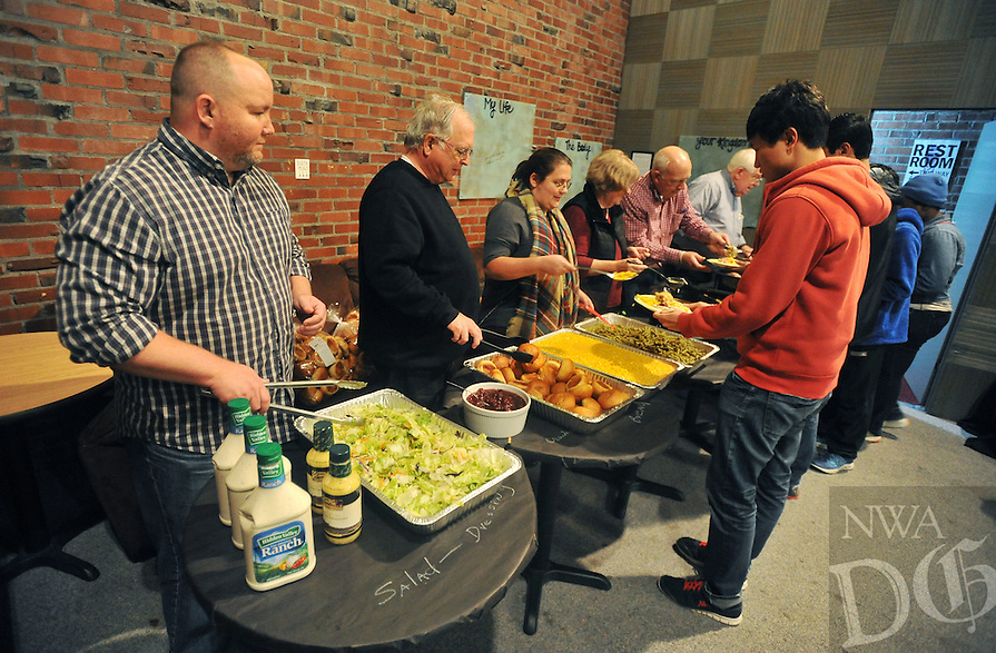 NWA Democrat-Gazette/MICHAEL WOODS &bull; @NWAMICHAELW<br /> Zach Davis, (from left) Gene Bursey, Aimee Meyer, Carol Bursey, John Meyer and George Panter, serve up a free meal Tuesday, November 17, 2015 during the  34th annual Thanksgiving dinner for UA students at the Rock House in Fayetteville.  The event hosted by Christ on Campus, a non-denominational ministry on the UA campus, feeds around 300 university students.  It is a cooperative effort with Christ on Campus and several local churches including Community Christian Church in Fayetteville and Rogers Christian Church.