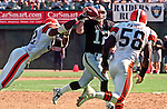 Oakland Raiders vs. Cleveland Browns at Oakland Alameda County Coliseum Sunday, September 24, 2000.  Raiders beat Browns  36-10.  Cleveland Browns defensive end Courtney Brown (92) and linebacker Wali Rainer (58) rush Oakland Raiders quarterback Rich Gannon (12).