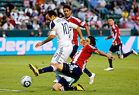 LA Galaxy midfielder Landon Donovan is tackled by Chivas USA defender Carlos Borja. The LA Galaxy beat Chivas USA 2-1 at Home Depot Center stadium in Carson, California on Sunday October 3, 2010.