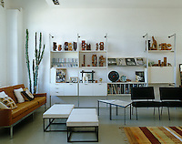 A storage unit by George Nelson dominates one wall of the living area and the floor of the loft has been painted