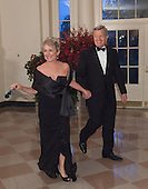 Max Baucus,U.S. Ambassador to China and Melody Hanes arrive at the State Dinner for China's President President Xi and Madame Peng Liyuan at the White House in Washington, DC for an official State Visit Friday, September 25, 2015. Credit: Chris Kleponis / CNP