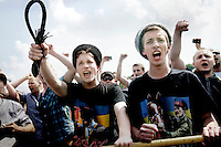 Ultra-nationalists, wearing cossack style hats and holding whips, shout abuse at participants taking part in a Gay Pride Rally on 29 June 2013. Anti-gay protestors later violently assaulted some of the people taking part in the rally. On 30 June 2013, Russian President Vladimir Putin signed into law an ambiguous bill banning the 'propaganda of nontraditional sexual relations to minors'. The law met with widespread condemnation from human rights and LGBT groups. The law has since been used to ban Gay Pride Rallies in the city. (MANDATORY CREDIT   photo: Mads Nissen/Panos Pictures /Felix Features)