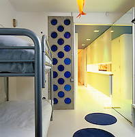 One of the children's bedrooms can be sealed off from the kitchen by a heavy mirrored door