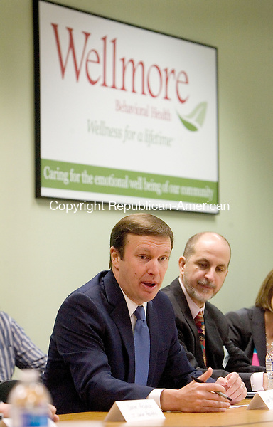 WATERBURY CT. 13 April 2015-041315SV06-Sen. Christopher S. Murphy, D-Conn, left, speaks during a roundtable discussion on the importance of addressing mental health prevention, intervention, and treatment in the 114th Congress at Wellmore in Waterbury Monday. Gary Steck, CEO of Wellmore, at right. <br /> Steven Valenti Republican-American
