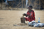 A boy sells peanuts in an internally displaced persons camp in Manangui, South Sudan. Families started arriving here shortly after fighting broke out in December 2013, and new families continued to arrive in March 2014 as fighting continued. Many are living in the open and under trees. The ACT Alliance is providing the displaced families and the host communities affected by their presence with a variety of support, including new wells.