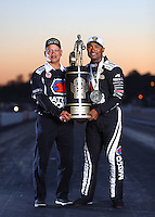 Nov 13, 2016; Pomona, CA, USA; NHRA top fuel driver Antron Brown (right) and his father pose for a portrait with the world championship trophy following the Auto Club Finals at Auto Club Raceway at Pomona. Mandatory Credit: Mark J. Rebilas-USA TODAY Sports