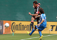 WASHINGTON, D.C. - AUGUST 19, 2012:  Emilliano Dudar (19) of DC United boots the ball away from Gabriel Farfan (15) of the Philadelphia Union during an MLS match at RFK Stadium, in Washington DC, on August 19. The game ended in a 1-1 tie.