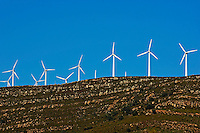 Wind turbines on ridge above the Playa De Los Lances, Tarifa, Andalusia, Spain.