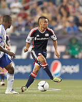 New England Revolution substitute forward Fernando Cardenas (80) dribbles. In a Major League Soccer (MLS) match, Montreal Impact defeated the New England Revolution, 1-0, at Gillette Stadium on August 12, 2012.