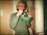 BNPS.co.uk (01202) 558833<br /> Picture: Warhol<br /> <br /> Andy Warhol Eating Corn Flakes at The Factory<br /> <br /> Never-before-seen photographs of celebrities captured in informal moments by the artist Andy Warhol are to be sold. The American pop artist used photography as a medium of art towards the end of his career and had a tendency to snap spontaneous moments. Many of his subjects were showbiz friends who frequented the same nightclubs as Warhol or visited his luxurious beach house or vast 'factory'. They included the likes of John Lennon, Mick Jagger, Elizabeth Taylor, Madonna, Sting, Bruce Springstein, Lizi Minnelli, Diana Ross and Debbie Harry. At the other end of the scale, he also turned his eye to capturing domestic items such as a room service tray, hotel chandeliers and even a row of urinals.