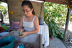 Adriana de Jesus Rodriguez, 16, washes dishes at her family's home. Living with several disabilities, she participates in the programs of Piña Palmera, a community based rehabilitation center in Zipolite, a town in Oaxaca, Mexico. Rodriguez plans on being a preschool teacher.