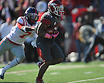 Arkansas running back Dennis Johnson (33) is chased by Ole Miss defensive back Trae Elston (7) at War Memorial Stadium in Little Rock, Ark. on Saturday, October 27, 2012. Ole Miss won 30-27...